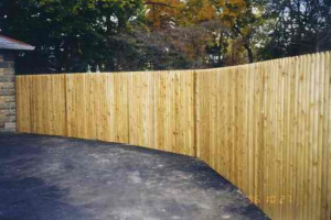 adding a wood privacy fence is a great way to define your property